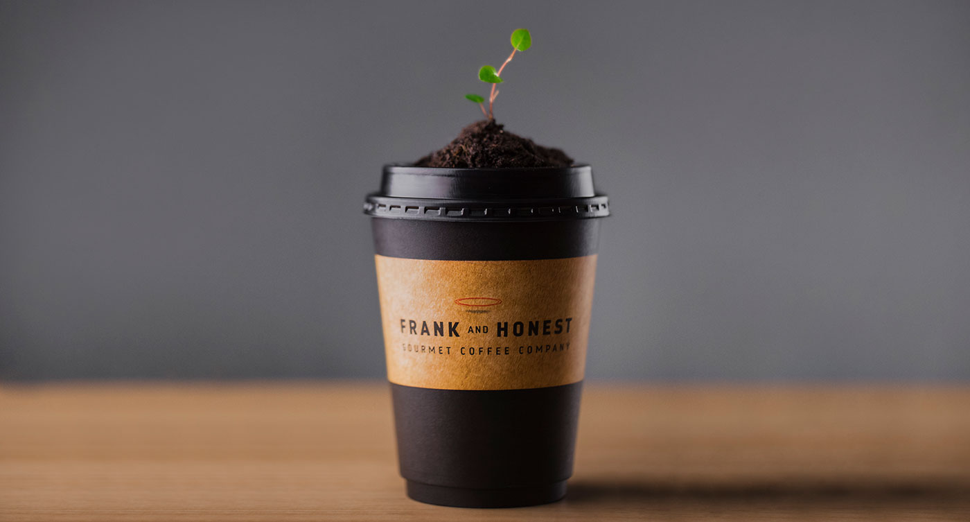 Coffee cup with plant in it